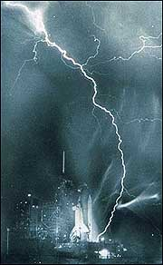 Lightning strikes the launchpad of Space Shuttle Challenger during thunderstorm